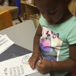 Alani hard at work coloring her poem.